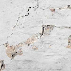 A cracked wall representing the slow effect of constant temptation